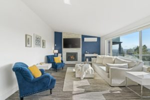 a living room with a blue accent wall