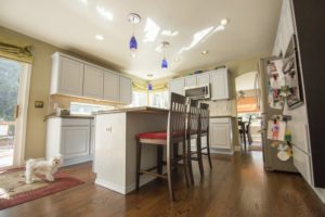 a kitchen with cabinets that are painted white